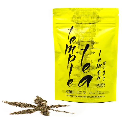 tea leaves shaped like cannabis plant next to product packaging