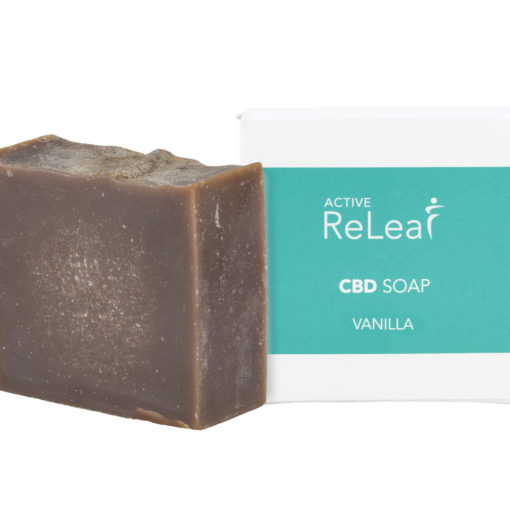 brown soap next to white and light green packaging