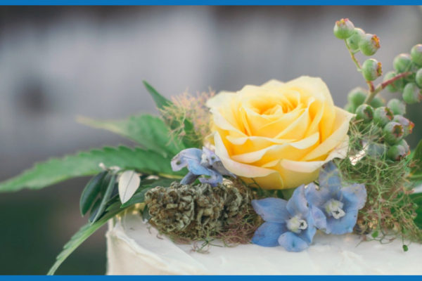 white cannabis cake with flower nug and other flowers for weddings